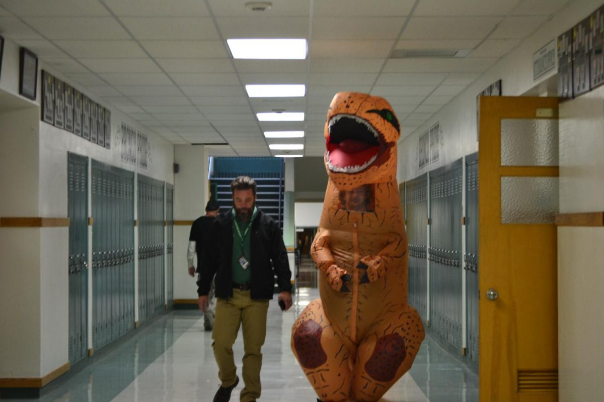 Mr. Abercrombie and Clay Udy (12), in the dino suit, showing off their school pride on Friday