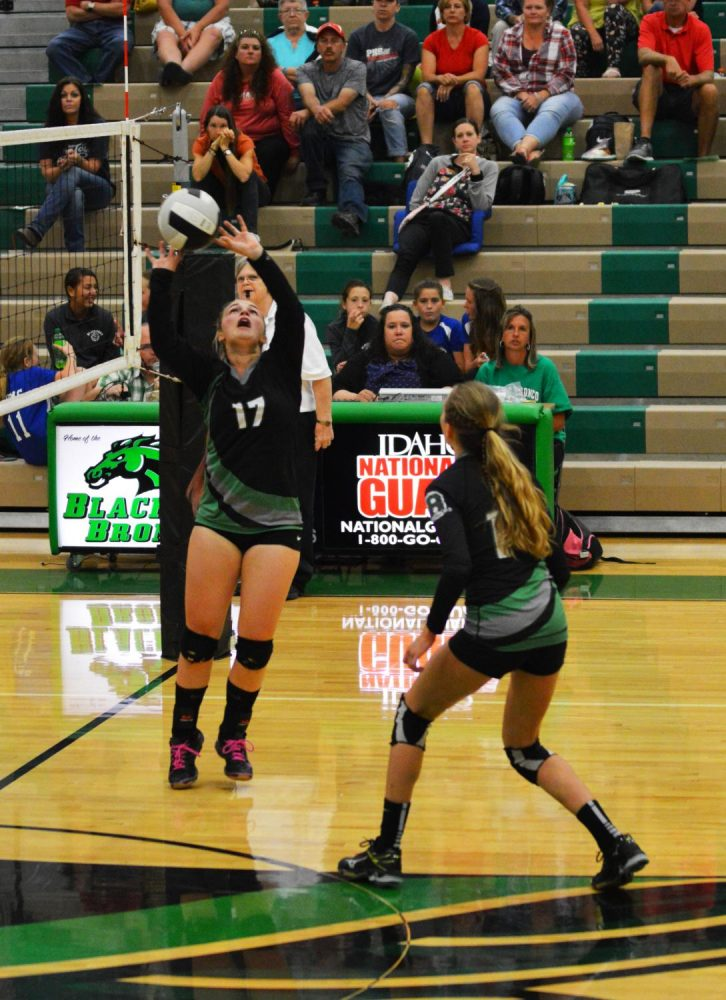 BUMP, SET, SPIKE! Josie Anderson (11) sets the ball for Kaitlyn Neff (10) to spike.