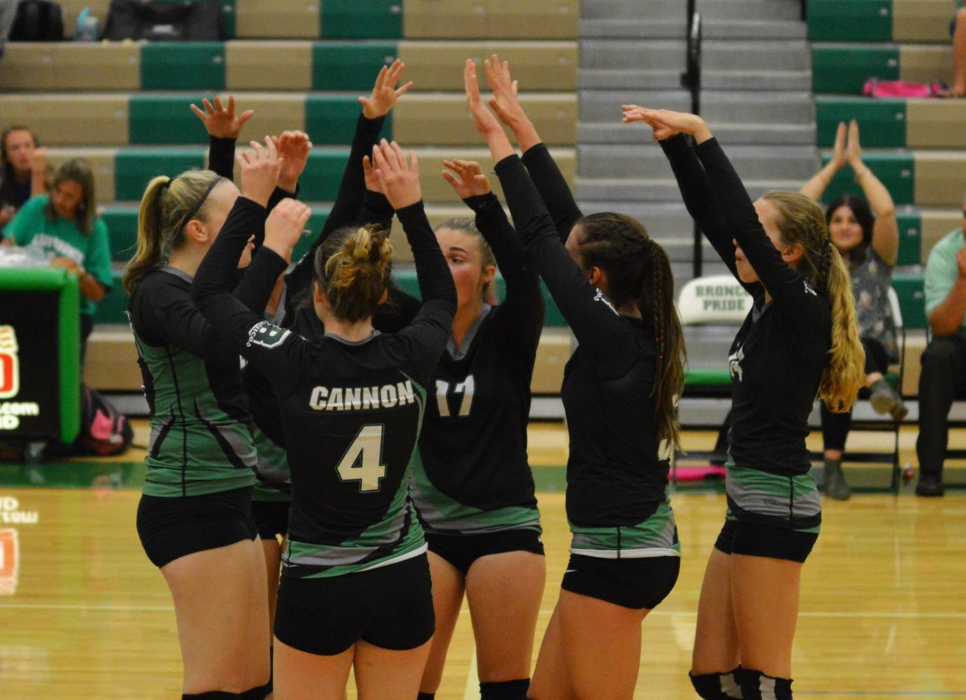 HANDS IN THE AIR. The varsity team rejoices over a point scored against Pocatello.