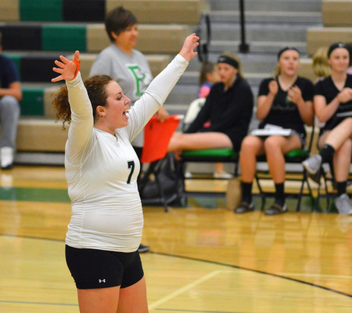 HOORAY. Hailey Pearson (12) celebrates a point scored for Broncos.