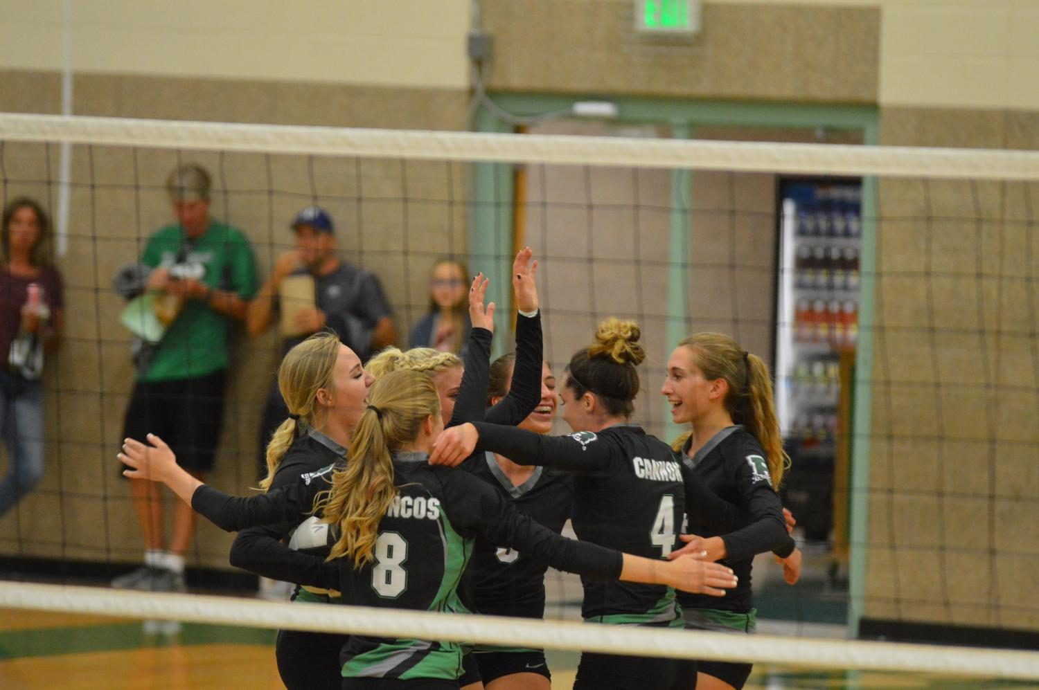 CELEBRATE GOOD TIMES COME ON. Varsity Girls celebrate a victory hit over Century.