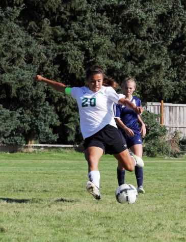 POWER. Sierra Sanchez stays ahead of pursuers while making an attack on the goal.