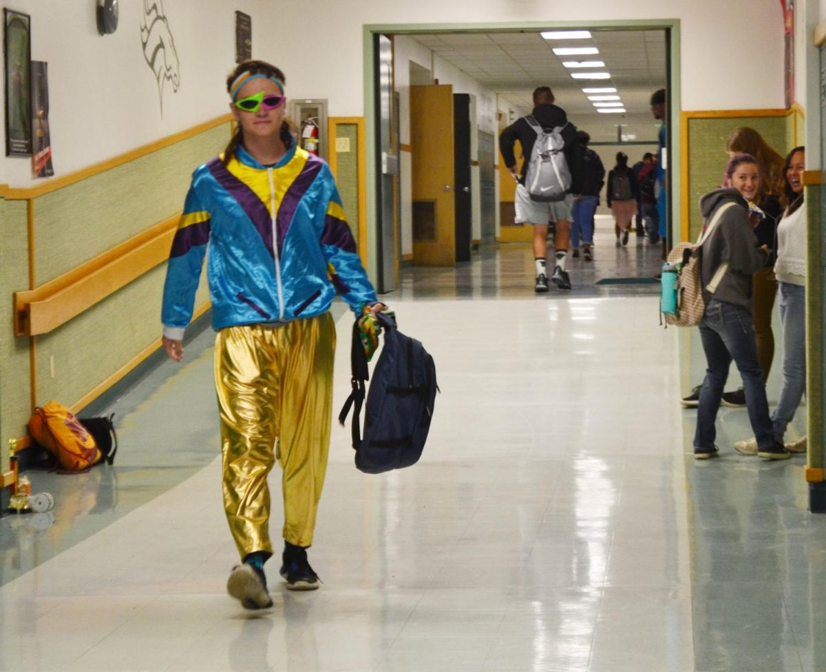 Braden Carson (12) throwing it back to the eighties as students stop and watch on