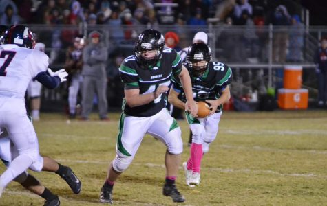 Cole Mays (12) protects the ball carrier Aric Vail (12).