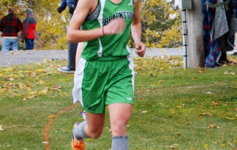 Abby Hurst (12) runs strong as she creates distance between competitiors to hold second place.