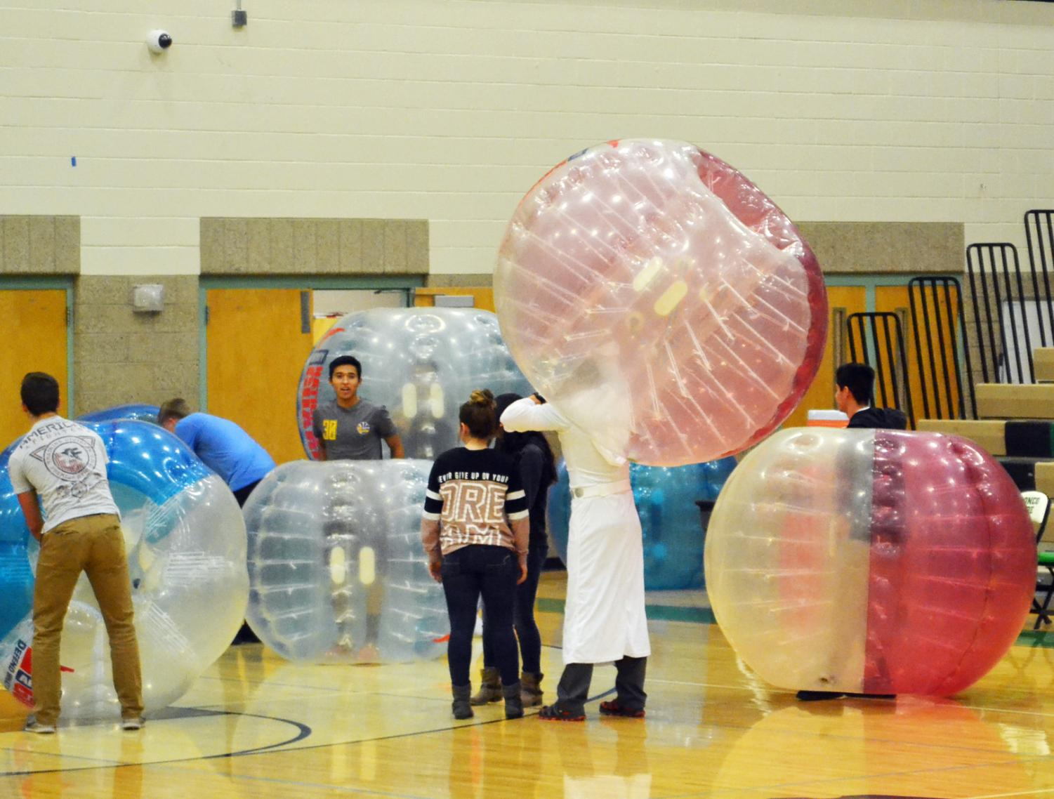 Students+are+invited+down+to+play+bubble+soccer+during+half+time+with+the+Vice+Principals.+
