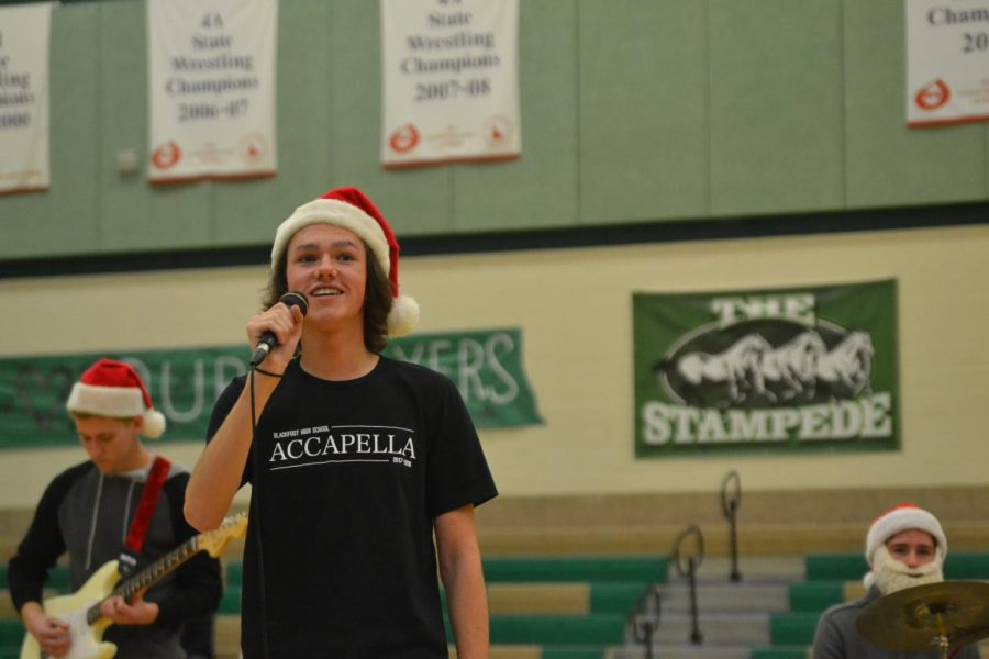 HOLIDAY MELODY. Porter Williams (11) sings a Christmas song during the assembly.
