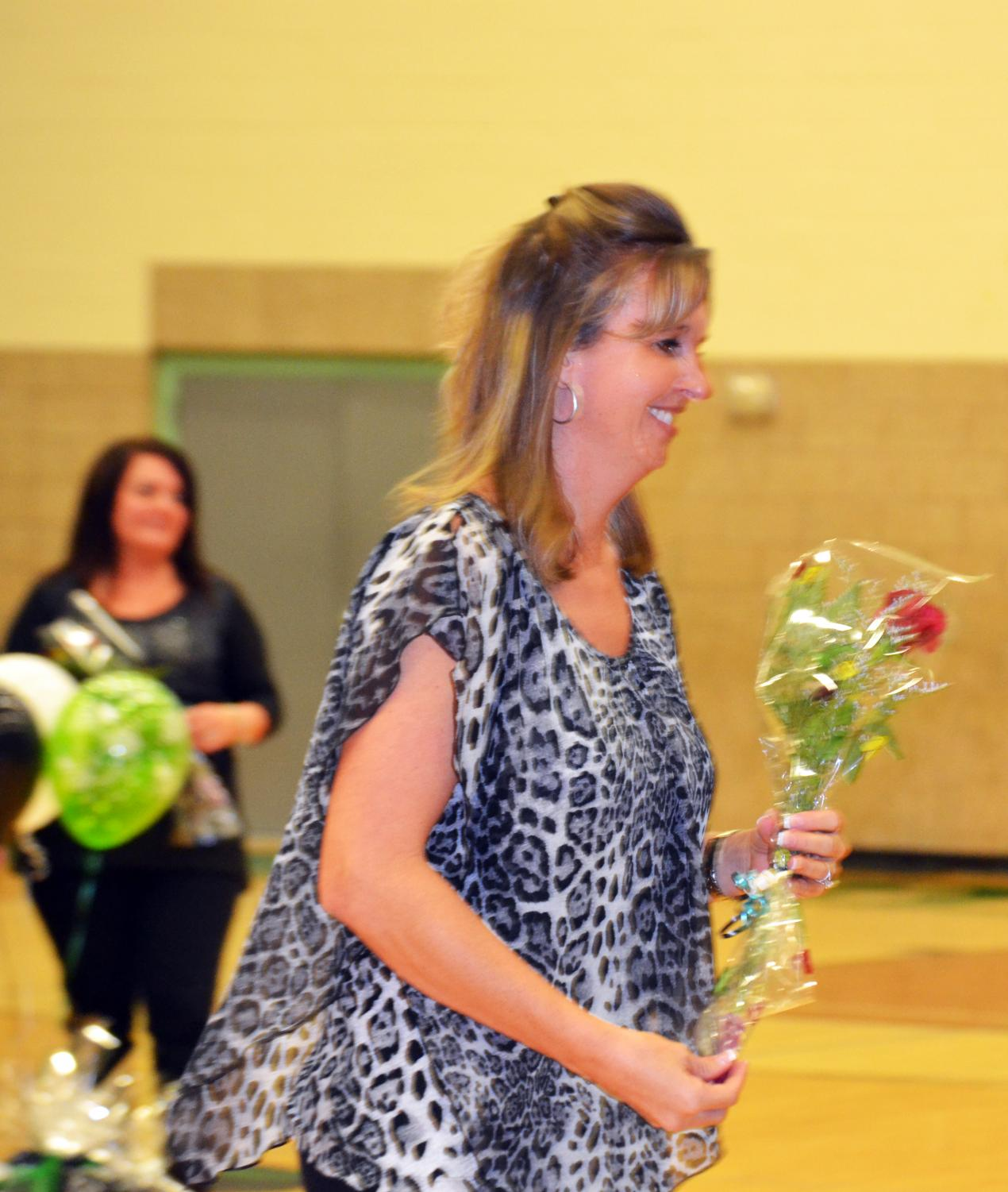 Head+Coach+Courtnie+Smith+recognized+with+flowers+at+Senior+night.+