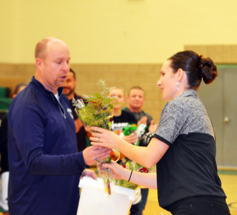 Coach+Raimee+Odum+given+flowers+by+Coach+Cody+Shelley.+
