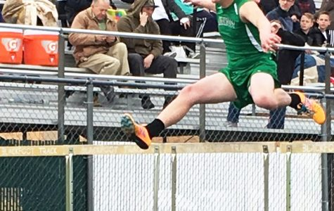Crea Conquist (12) powers through the 110 meter hurdles, achieving a new personal record.