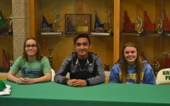 Three seniors sign to play sports for college teams in the fall