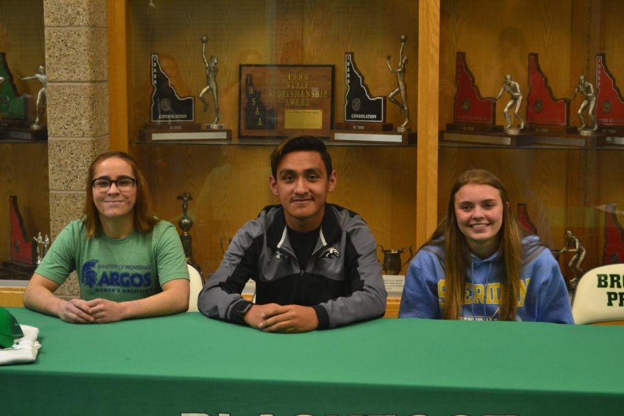 Lana Hunt (12), Junior Labra (12), and Jordyn Haxby (12) pose together following signing their Letters of Intent.