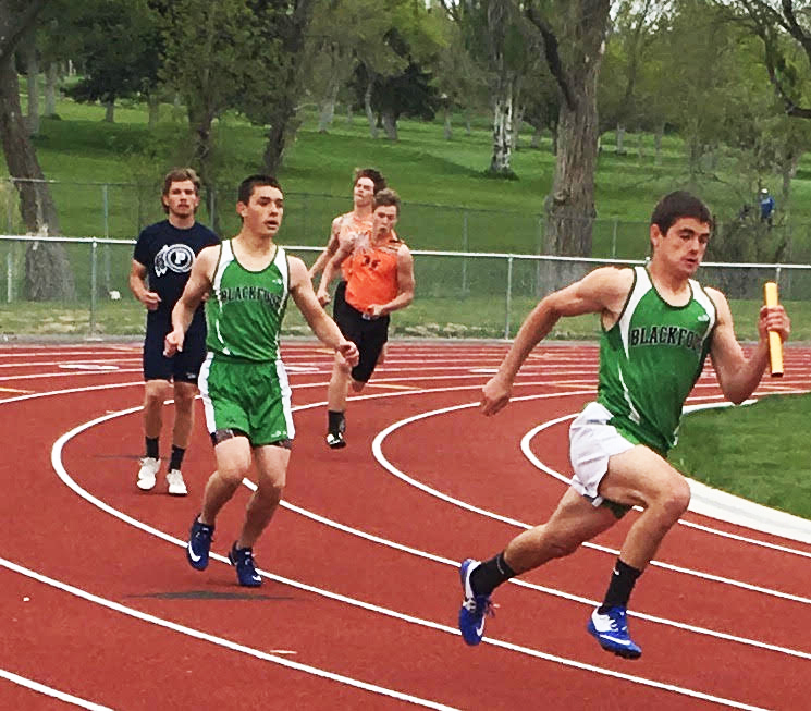 Ethan Jensen (9) and Daniel Andrade (11) running strong in the boys 4x100 meter relay.