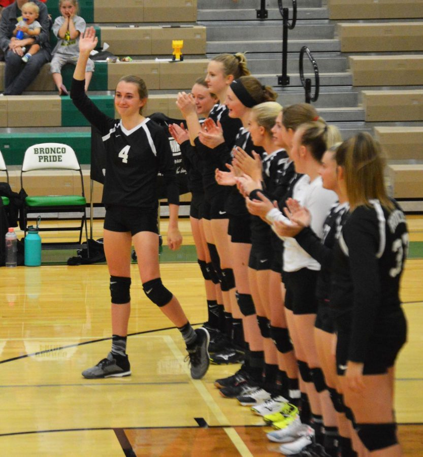 Kaitlyn Neff (11) waving at the crowd before the game
