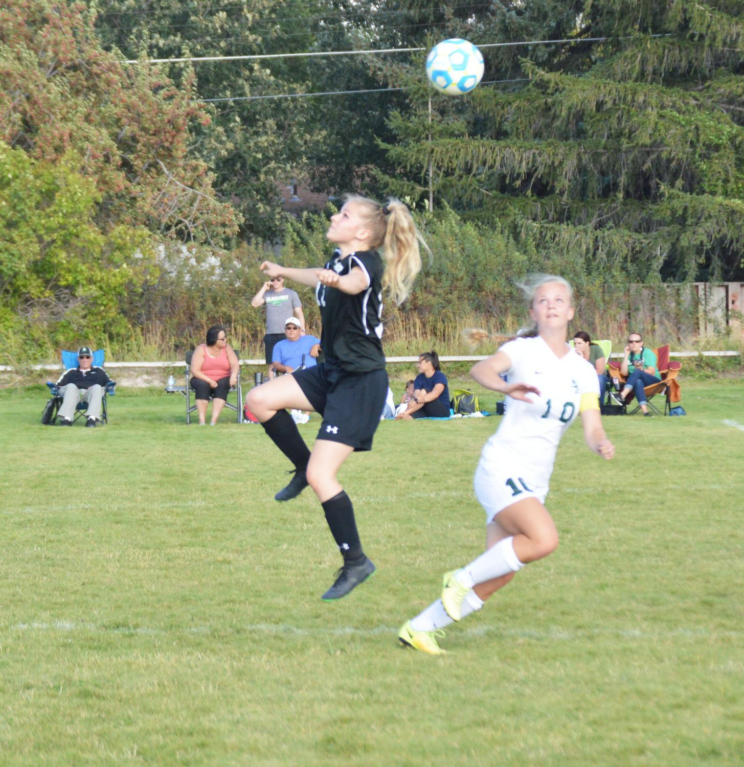 Kinsley Wray (12) headbutting the ball.