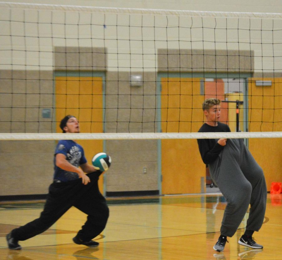 In between sets Daegan Simpson (12) and Nephi Bigler (12) play a riveting game of catch the ball in your sweatpants