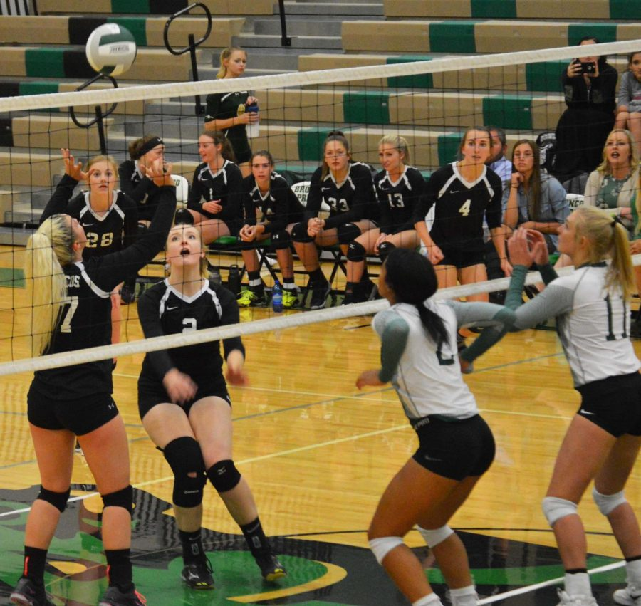 Josie Anderson (12) and Michaela Eldredge (12) getting ready to send the ball over the net