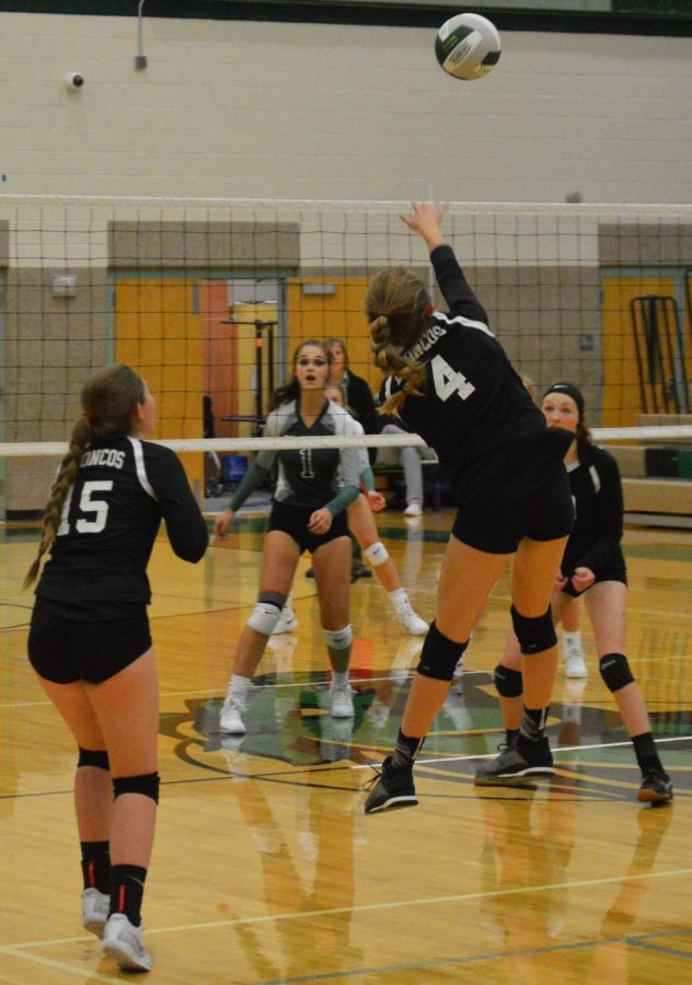Kaitlyn Neff (12)?? mid-air as she sends the ball over the net
