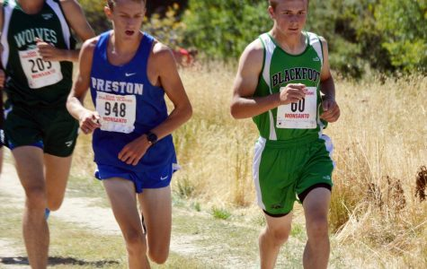 MEDALIST. Austin Despain (11) pushes forward in the race.