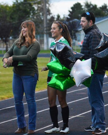 Ashlyn Smith (12) being brought out onto the field as she celebrates her last home game