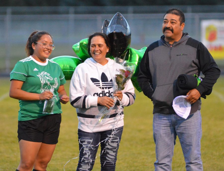 Jessica Chavez (12) being presented as she celebrates her last home game