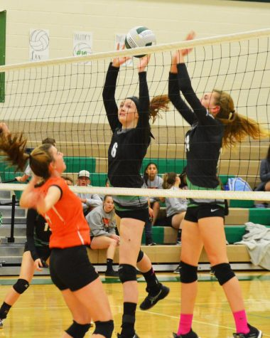 DOUBLE UP Hanna Hirschi(11) and Kaitlyn Neff(11) work together to score a point