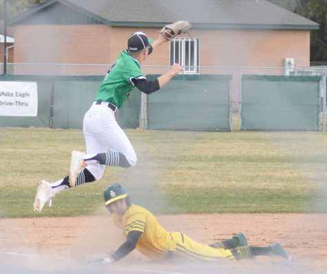 JUMP OF GLORY. Carter Cooper jumps high over Bonneville Bee to catch the ball at third.