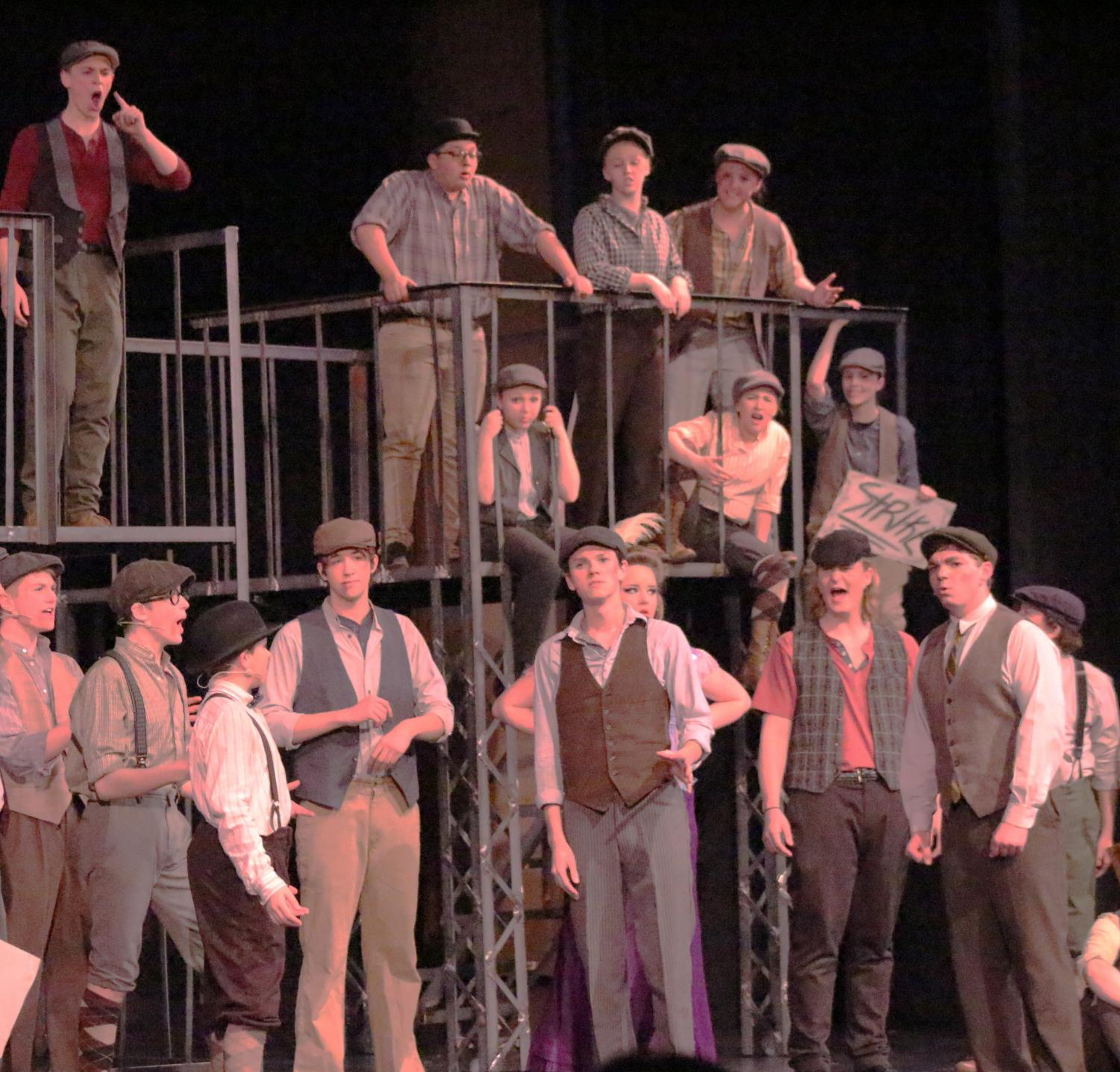RETHINKING+YOUR+OPTIONS.+Jack+Kelly+rethinks+the+strike+and+discusses+an+alternative+option+with+the+newsies.