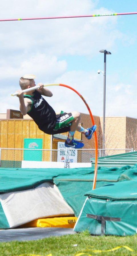 TOUCH THE SKY. Landon Abercrombie (12) shoots high in the sky in pole vault.