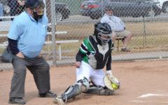 Malia Ta'Fui (12) catches strike from Tigers.